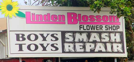 Smash repair and flower shop sign